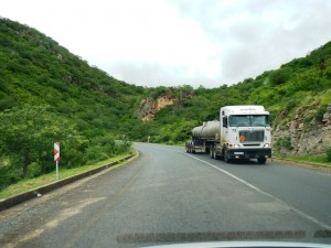 Truck driving on the right side of the road, which is ...left for South Africa
