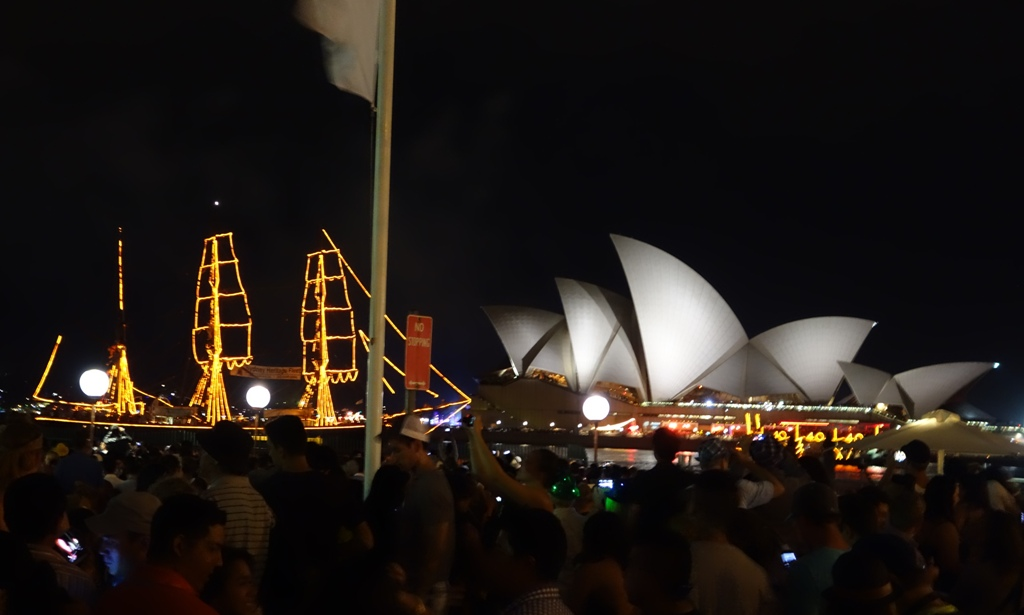 Opera house with a three mast sail boat lit up