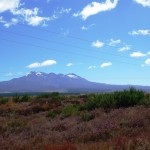 The three volcanoes: snow-capped Ruapehu to the left, conical Ngauruhoe far center and broad-domed Tongariro to the right