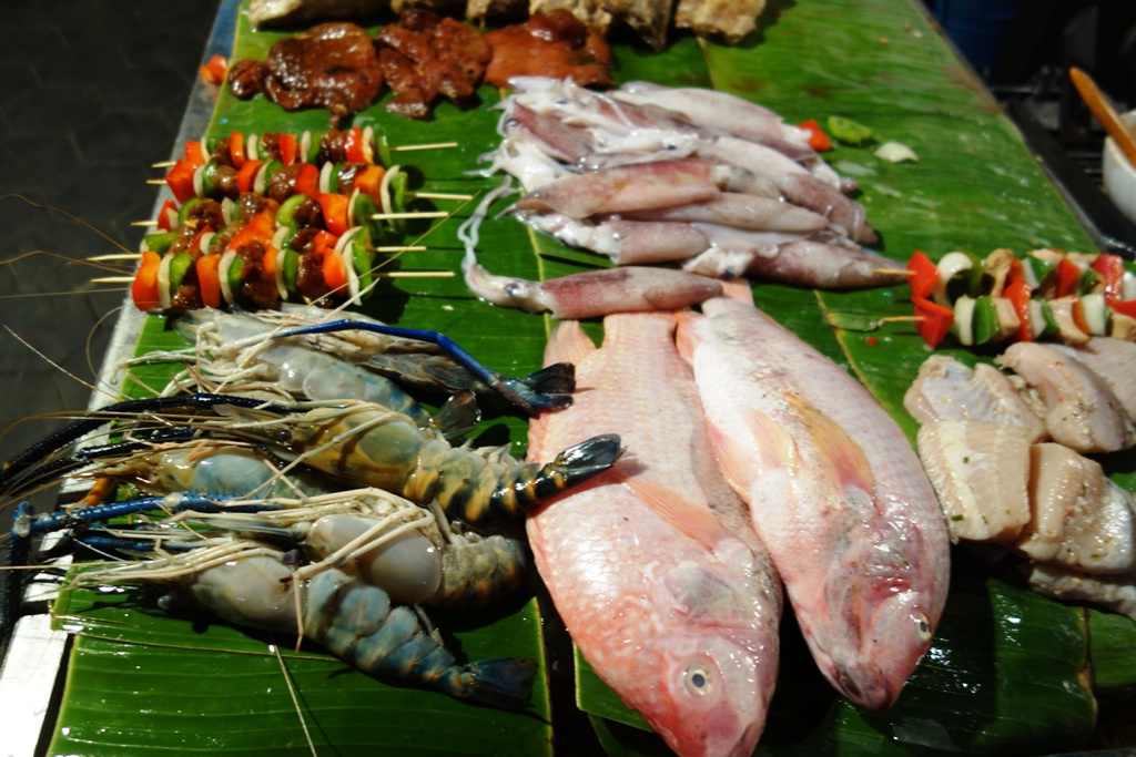 Seafood at the corner of the street - pick what you want and they will grill it for you on the spot